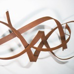 modern abstract weathered steel wall sculpture closeup