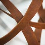 modern abstract weathered steel wall sculpture detail